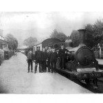 Ballachulish Station 1920. L-R, Station Boy, Engine Driver, Guard, Porter (back), Fireman, Station-master *Duncan MacIntyre and Signalman. Train about to depart Ballachulish Station, off the buffers and sitting with full head of steam. Source- Jessie MacKenzie * Duncan MacIntyre, in c1900 started as a Clerk at Dalmally Station, where his father was a Railwayman. By 1911 Duncan was Stationmaster at Ballachulish, aged only 25, and he remained there until c 1927 when he transferred to Appin Station where he died in service in 1943.