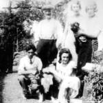 Druimn-A-Mhoina July 1934. Family of McNivens living at Druim-A-Mhonaidh, Appin. Dougie MacDonald (Kneeling) Creagan Station.